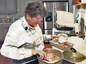 Carol McPhaul cooks in the kitchen of her newly remodeled home. Volunteers renovated the house for her and her disabled husband after a contractor left it a mess.