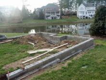 Seth Kaplan said Robert Sykes, owner of Triangle Outdoor Spaces, left his garden a cinder-block construction mess.