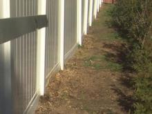 Nash County man at odds with builder over crooked fence