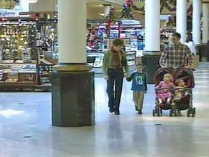 A family shops at Crabtree Valley Mall on Christmas Eve 2007.