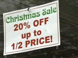 Stores in Oxford's downtown discounted items for after-Christmas sales.