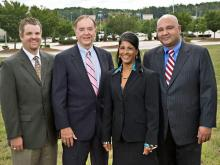 """MJM Real Estate Group and the Davidson and Jones Group plan to build a Courtyard by Marriott hotel at Triangle Town Center Mall. From left to Jack Love, general manager of Triangle Town Center; Robert L. """"Roddy"""" Jones, chair of Davidson and Jones Group; Vinita J. Mittal, founder and chair of MJM Real Estate Group; and   Anuj N. Mittal, president of MJM Real Estate Group. (Photo courtesy of MJM Real Estate Group)"""