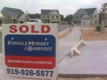 Multiple SOLD signs line a cul-de-sac in Johnston County.