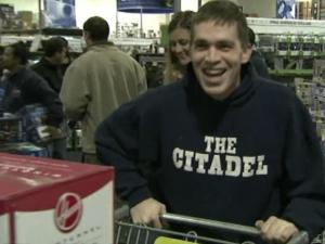 An early morning shopper celebrates the deals he found at the Best Buy store in Cary on Friday, Nov. 25, 2011.