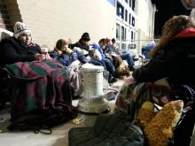 Bargain shoppers use blankets, bushes to wait for deals