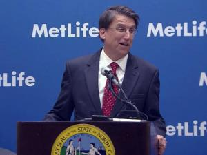 Gov. Pat McCrory announces that MetLife will bring 2,600 jobs to Cary and Charlotte during a March 7, 2013, news conference.