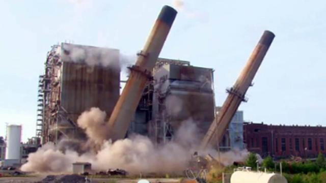 Duke Energy imploded two smokestacks at a former coal-fired power plant in Moncure on Aug. 22, 2014. The 90-year-old Cape Fear Plant was shut down in 2012 as Duke shifts to natural-gas fired plants to reduce air pollution. (Photo courtesy of Duke Energy)