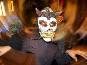 A reveler dressed as a ghost enjoys a Halloween festival. (AP Photo/Vincent Yu)