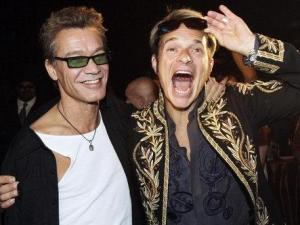 David Lee Roth, right,  poses with bandmate Eddie Van Halen in Van Halen, after they announced their new North American tour in Los Angeles on, Aug. 13. (AP Photo/Kevork Djansezian)