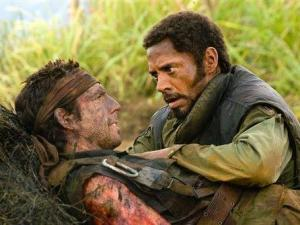 """In this image released by Paramount Pictures, Ben Stiller, left, and Robert Downey Jr. are shown in a scene from, """"Tropic Thunder."""" (AP Photo/Paramount Pictures, Merie Weismiller Wallace)"""