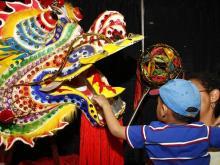 Aaron and Osha Watkins inspecting a Chinese dragon.