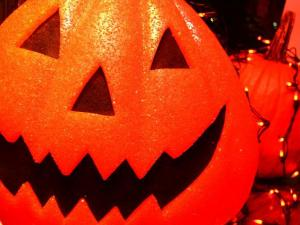 Halloween decorations adorn various Franklin Street store fronts.