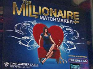 """A poster advertises """"The Millionaire Matchmaker"""" during an event with the show's host, Patti Stanger, at Solas on Glenwood South in Raleigh on Friday, Feb. 13, 2009."""