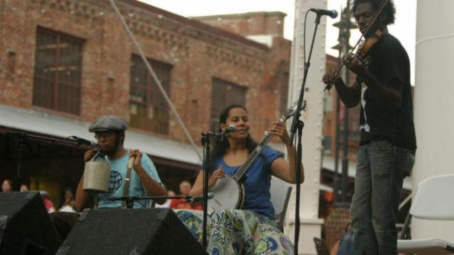 Old-time string band Carolina Chocolate Drops played a free outdoor concert Thursday night at the American Tobacco Campus in Durham.