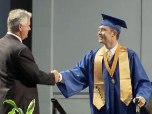 Scotty McCreery accepts his high school diploma.