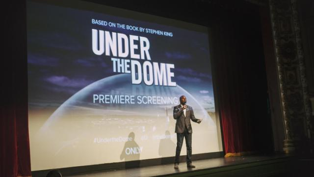 """omg! Insider host Kevin Frazier introduces the cast before the screening of """"Under The Dome"""" in Thalian Hall."""