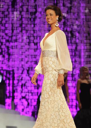 The newly crown Miss North Carolina Johna Edmonds competes in the evening gown portion of the scholarship pageant.