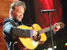 John Mellencamp on stage at Walnut Creek Amphitheater in Raleigh. The annual Farm Aid benefit concert makes a stop in North Carolina on Sept. 13, 2014. (Chris Baird / WRAL Contributor).