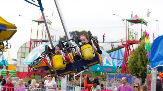 Hanna and Ethan McMinn, of Apex, ride the gliders. Photographer: Carlton Bassett
