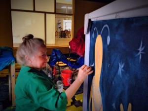 Artist Leatha Koefler is putting the finishing touches on props that will be on display during First Night Raleigh.