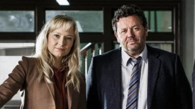 "Fern Sutherland and Neill Rea star in ""The Brokenwood Mysteries,"" a New Zealand rural police procedural. The second season is now on Blu-ray and DVD. (Deseret Photo)"
