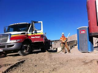 """Stuart Edgington, known as Stuart Edge, cleans out a portable toilet. Edge shares his experiences and life lessons in his recent book, """"On the Edge: How My Crappy Job Changed My Life."""" (Deseret Photo)"""