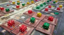 To score points in the Lords of Vegas, a player needs to control certain areas. The more presence players have in an area, the more powerful they can become to take over other colors. In this photo, red has an advantage while yellow could get knocked out. (Deseret Photo)