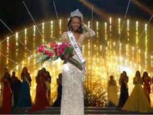 A Fayetteville native whose mother is battling lung cancer was named Miss USA Sunday night.