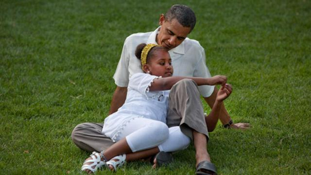 President Barack Obama sits with his daughter Sasha during a barbecue with family and friends in celebration of his 49th birthday on the South Lawn of the White House, Aug. 8, 2010. (Deseret Photo)