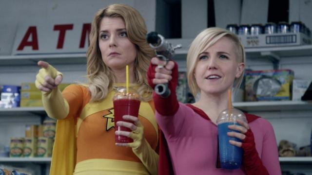 """Internet comedians Grace Helbig, left, and Hannah Hart star as self-styled superheroes in the movie adaptation of the 1970s Sid and Marty Krofft TV series """"Electra Woman & Dyna Girl,"""" now on DVD. (Deseret Photo)"""