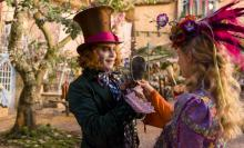 """Alice (Mia Wasikowska) returns to the whimsical world of Wonderland and travels back in time to save the Mad Hatter (Johnny Depp) in Disney's """"Alice Through the Looking Glass,"""" which was criticized for its overuse of CGI. (Deseret Photo)"""