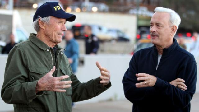 """Clint Eastwood, left, gives direction to Tom Hanks on the set of """"Sully."""" The film is playing in local theaters. (Deseret Photo)"""