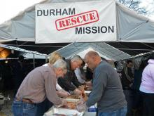 More than 600 volunteers help prepare hundreds of turkeys and other fixings for the Durham Rescue Mission's annual Christmas dinner and giveaway on Dec. 23, 2011. (Photo courtesy of the Durham Rescue Mission)