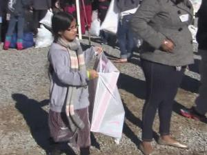 Children got toys and everyone took home warm clothes and groceries Friday from the Durham Rescue Mission Christmas celebration.