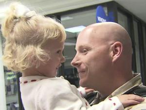 Navy Reservist Lt. Steven Harrell, of Pembroke, greets his 21/2-year-old daughter Pyper at the Fayetteville airport on Friday, Dec. 23, 2011. He returned home early from a yearlong deployment to Iraq.