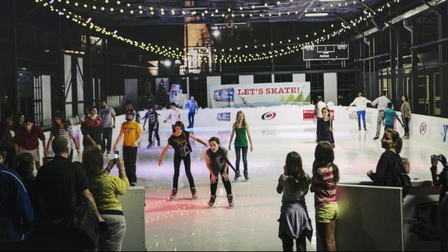 Children and families frolic at the Ice Factory at the Cage - a new ice skating rink sponsored by the Carolina Hurricanes on the American Tobacco Campus.