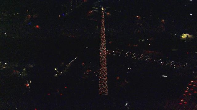 Sky 5 gets an aerial view of the WRAL tower lit for the holidays.