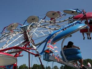 Flying high in the sky on a carnival ride