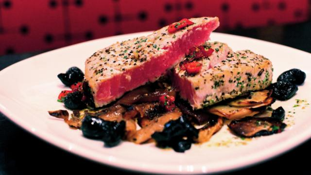 Seared tuna, charred fennel and onion, oil-cured olives, Fresno chilis, herb oil