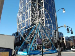 The ferris wheel sits at the corner of East Hargett and Fayetteville streets.