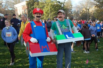 Racers often come in costume to the Krispy Kreme Challenge. The goal is to run about 2.5 miles to Krispy Kreme, eat a dozen donuts and run back.