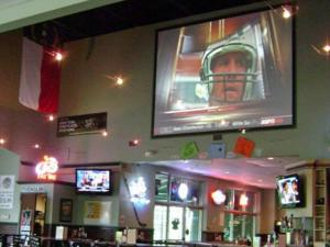 The projection screen is the centerpiece of Rudino's Sports Porch in Apex.