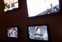 A wall of HD TVs draws the attention of diners at Tobacco Road.