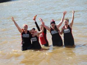The Carolina Rollergirls celebrate after taking the Polar Plunge.