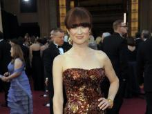 Ellie Kemper arrives before the 84th Academy Awards on Sunday, Feb. 26, 2012, in the Hollywood section of Los Angeles. (AP Photo/Chris Pizzello)