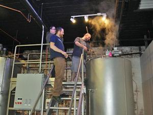 The folks at Mystery Brewing christen the brewhouse. (Image from Mystery Brewing)