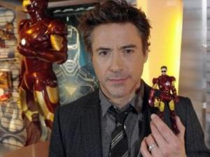 "Robert Downey Jr. holds up his ""Iron Man"" action figure. (Undated photo)"