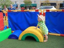 Babies enjoy the Go Ask Mom North Hills Event