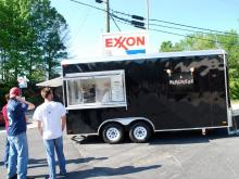 Customers wait for souvlakis from Mama Dukes food truck parked at Sam's Quik Shop, at 1605 Erwin Road, in Durham.