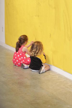 Two little girls participate in hands-on activities at the Contemporary Art Museum Friday night at First Friday in Raleigh (photo by Wes Hight).